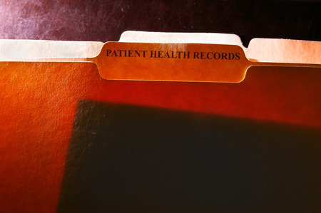 folder: carpetas de archivos con el paciente etiqueta Registros de Salud Foto de archivo
