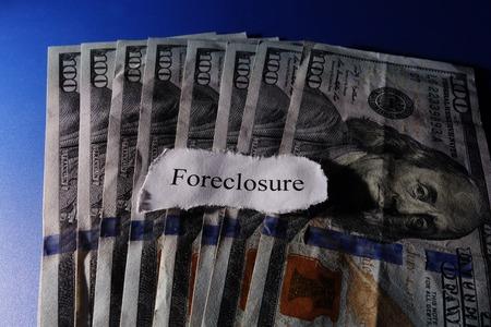 Foreclosure paper headline on money