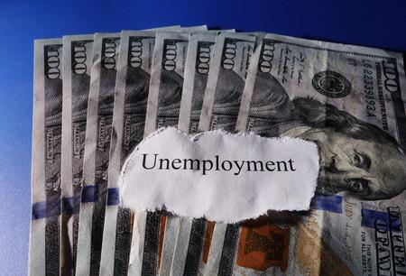Unemployment paper scrap on money