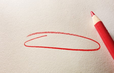 red pencil: Red circle and pencil on textured paper Stock Photo