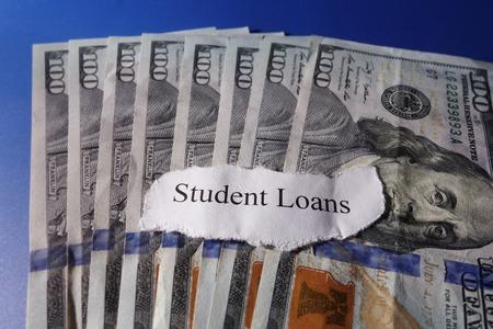student loan: Student Loan paper scrap on cash