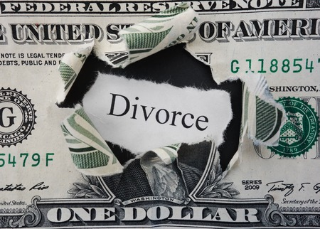 alimony: Hole ripped in a dollar bill with Divorce text Stock Photo