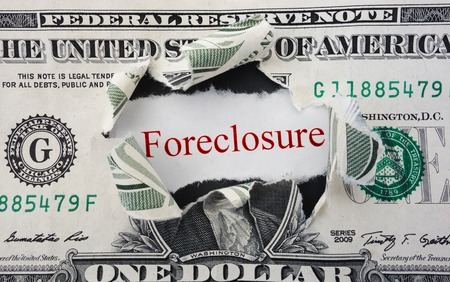 foreclosure: Foreclosure text in ripped dollar bill