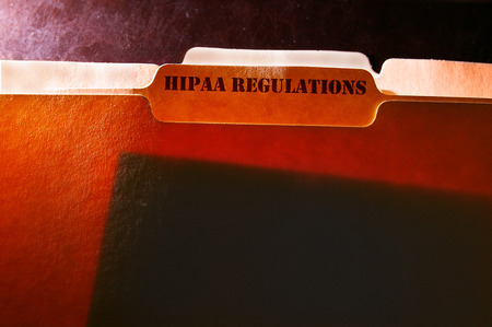 tabbed file folders with HIPAA Regulations text