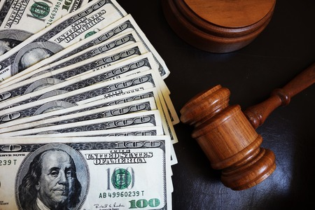 Legal court gavel on assorted cash