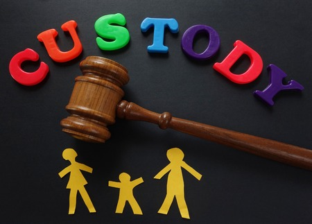 Paper family and gavel with Custody in play letters