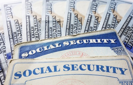 Social Security cards and hundred dollar bills