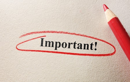 important: Important text circled in red pencil on textured paper