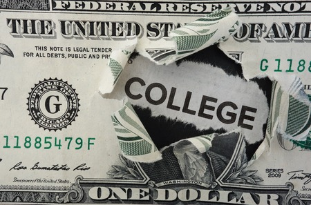 Paper headline with College text in torn dollar bill Stock Photo