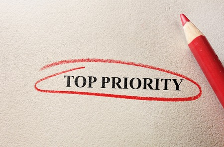 priority: Top Priority text circled in pencil on textured paper