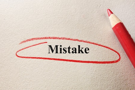 Red circled Mistake on textured paper photo