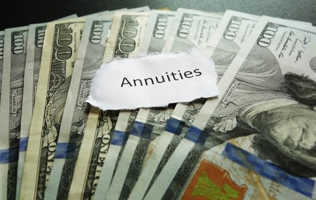 annuities: Annuity note on top of assorted cash