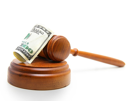 auction win: judges court gavel and hundred dollar bill, on white