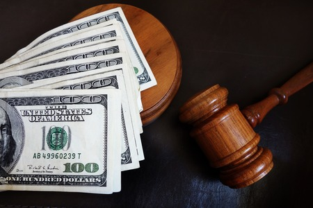 support: Judges court gavel and assorted money Stock Photo