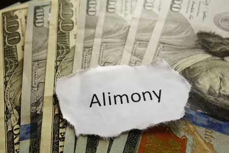 divorce court: Closeup of Alimony paper note on cash Stock Photo