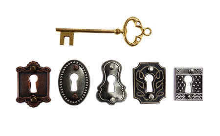 antique keyhole: Assorted antique locks with gold key, isolated on white