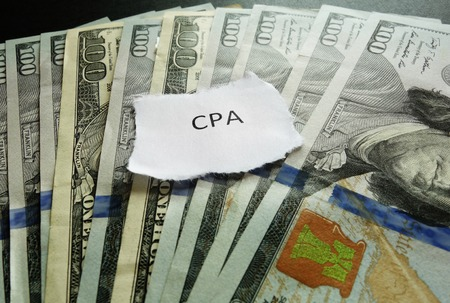 cpa: CPA paper scrap on money - Certified Public Accountant concept Stock Photo