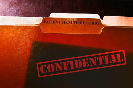 private information: file folders with Patient Health Records label and Confidential stamp