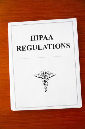 HIPAA Regulations documents on a desk Standard-Bild