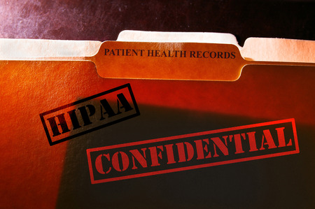 Patient Health Records folder with Confidential and HIPAA stamps photo