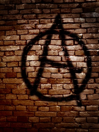 anarchy: Anarchy symbol spray painted on a brick wall Stock Photo