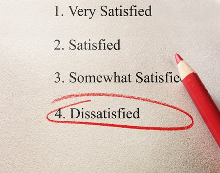 rating: Dissatisfied survey with red circle and pencil on textured paper Stock Photo