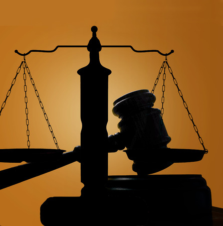judges court gavel and scales of justice silhouette