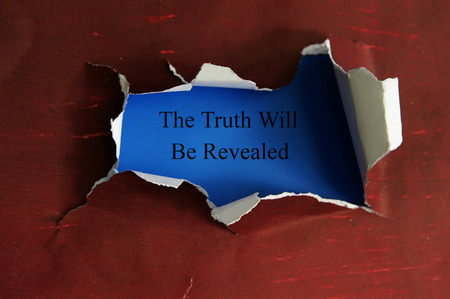 revealed: hole torn in a piece of paper with The Truth Will Be Revealed