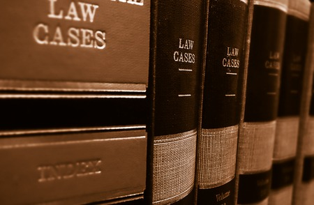 legal law: Law cases and law books on a shelf