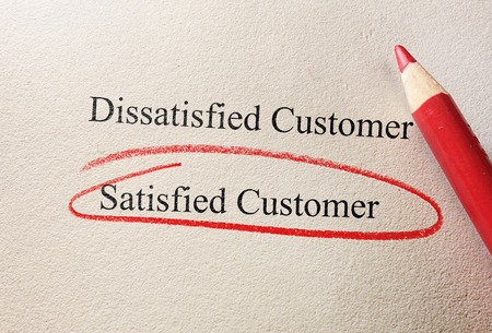 satisfied customer: Red pencil Satisfied Customer on questionnaire Stock Photo