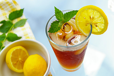 iced tea: tall glass of iced tea with lemon and fresh mint Stock Photo