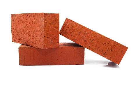 clay brick: three red clay bricks stacked up on white