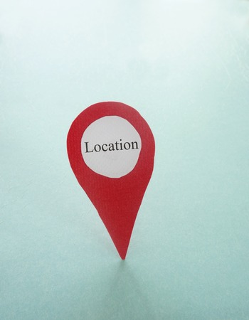 exact position: Red locator symbol with Location label, on blank blue texture