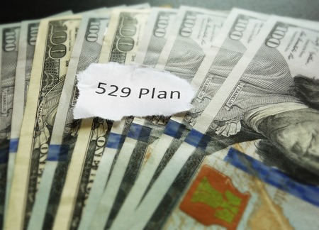 save: Closeup of 529 Plan paper note -- college saving plan concept