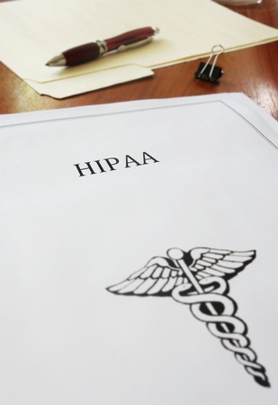 government regulations: HIPAA healthcare document on an office desk Stock Photo
