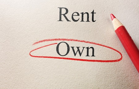 home owner: Rent or Own text on paper with Own circled  home owner concept