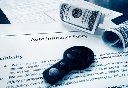 Auto insurance policy with cash and car key photo