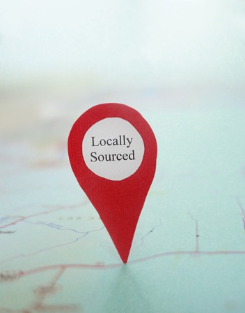 locally: Red locator Locally Sourced symbol on a map
