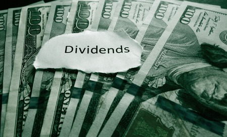 diversification: Hundred dollar bills with Dividends news headline