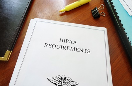 private information: HIPAA Requirements healthcare privacy document on an office desk