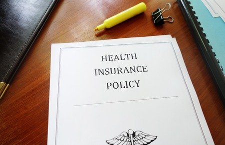 Health Insurance Policy on an office desk