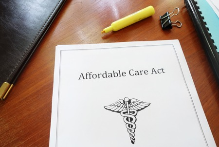 Affordable Care Act document on an office desk. Stock Photo