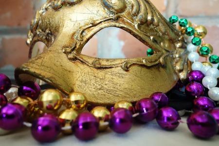 Mardi gras masquerade mask and beads