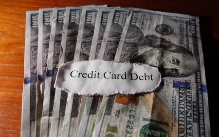 credit card debt: Credit Card Debt paper message on cash