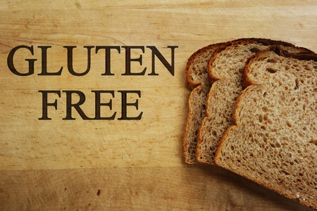 Gluten Free on cutting board with bread slices