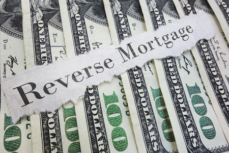 Reverse Mortgage paper message on assorted cash