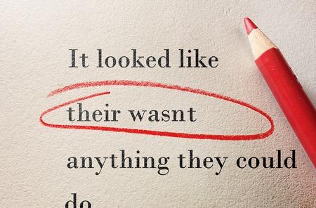Red pencil circle around incorrect spelling -- Editor proof reader or teacher concept Foto de archivo