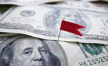 retirement savings: Flag with Retirement Savings message on cash