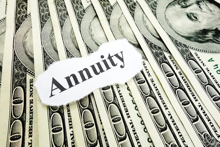 annuities: Annuity paper message on hundred dollar bills Stock Photo