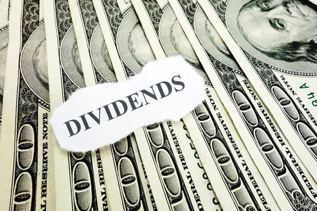 dividends: Dividends message on hundred dollar bills